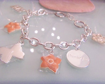 NINA RICCI Premier Jour charm links pendant bracelet