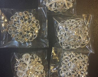 Assorted rhinestone brooches