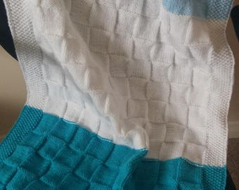 Hand-knit baby blanket.