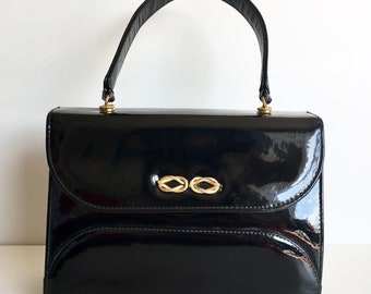 Vintage 60s iconic black patent leather vintage Kelly top handle bag with exquisite gilt rope detail to clasp by Riviera made in England