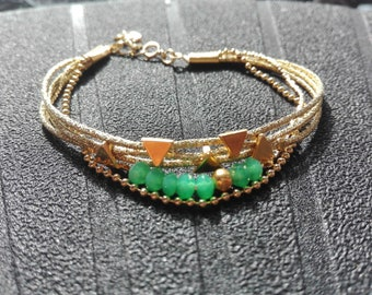 Gold and green multi strand bracelet