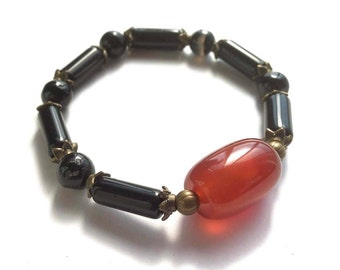 Stretch Beaded Bracelet, With Black Agate Beads, a 2 cm Wide Red Agate Gemstone and Antiqued Brass Accents