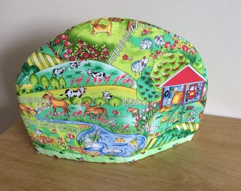 Hand made Fabric Tea Cozy in Farmyard Print Fabric. Fits a 2 to 4 cup teapot.