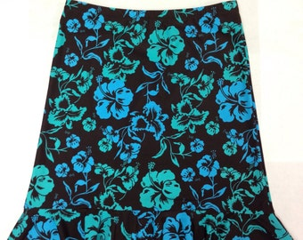 Flounce skirt with elastic waist. Printed spandex: brown with blue and green hibiscus flowers, flounce skirt with elastic waist