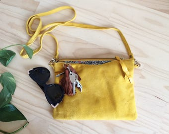 Leather, crossbody bag or clutch.