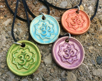 Om symbol medallion necklace.