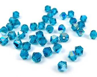 50 x® 4 mm BLUE ZIRCON AB Swarovski Crystal bicones
