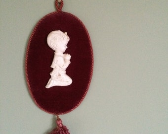 Vintage red velvet wall hanging with praying child