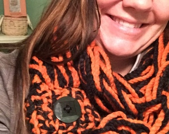 Arm knit scarf in black and orange. Can do other school colors upon request.