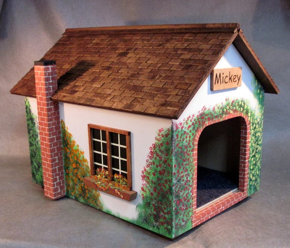 Cat cottage with wood tiled roof