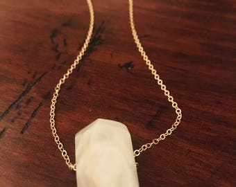 Moonstone and gold pendant