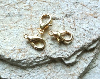 Set of four 15 lobster clasps x 9 mm gold metal
