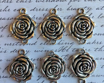 Four pewter rose pendents