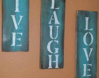 Three pallet signs. Live, Love, Laugh.