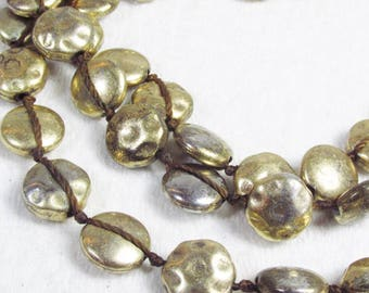 Vintage hammered brass beads necklace.