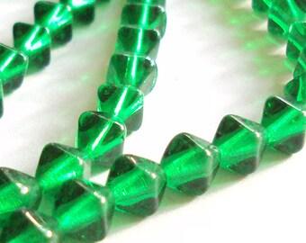 Czech glass Emerald green x 100, 8mm bicone, pressed beads