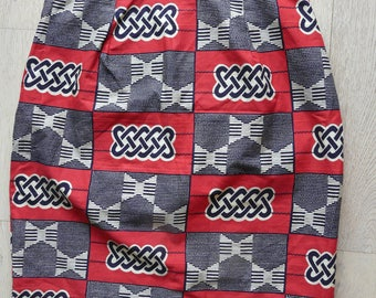 straight skirt in ethnic, graphic printed cotton in bright red, black and ecru, wax zipper on the back
