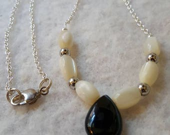 White line black agate/mother of pearl necklace with silver chain.
