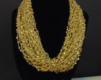 necklace, costume, splash of gold
