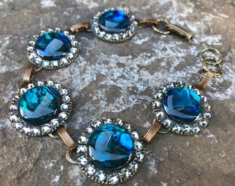 Vibrant Blues and Swarovski Silver Night Crystals Make This Oxidized Brass Bracelet Featuring Paua Shells Sparkle