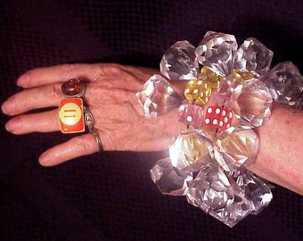 two signed jan carlin designer lucite diamond and dice bracelets