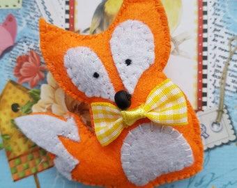 Cute felt fox brooch with yellow bow.