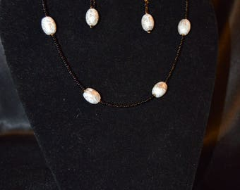 Black and white bead necklace and earrings set.