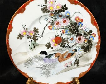 A beautiful Meiji period, porcelain plate