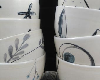 White bowl with black drawings