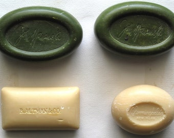 Four mid-20th century department store monogrammed soaps