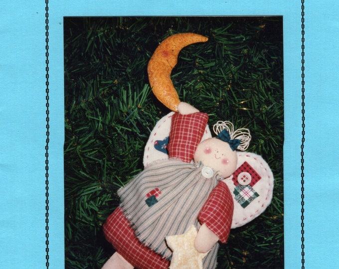Free Us Ship Sewing Pattern Craft Unused Homespun Hill Moonbeam Folk Art Primitive Angel Doll hanging from the moon. 111 1993 Sharon Morris