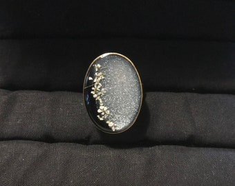 Silver and black flower ring