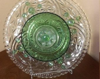 glass plate flower, yard art