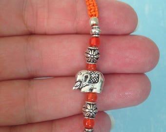 Orange elephant macrame bracelet