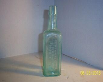 1890's Potter Drug & Chemical  Boston, Ma Cuticura Treatment for Skin 7 1/2 inch Aqua medicine bottle