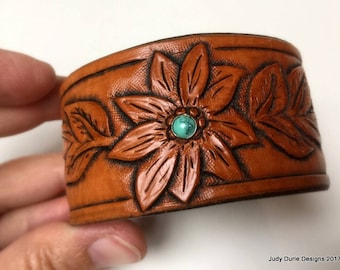 Tooled leather cuff with turquoise rivet