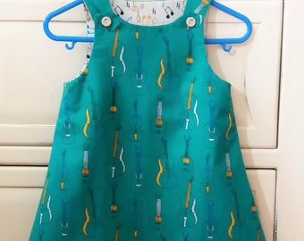Baby dress, pinafore, girls dress, summer dress, musical instruments dress, handmade dress, christening gift, naming day gift. Age 6-9 mths