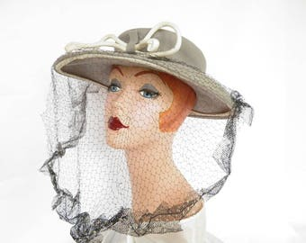 1940s vintage hat, gray with black veil. woman's, WW2 era