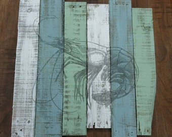 Shrimp painted on blue green and white distressed wood boards