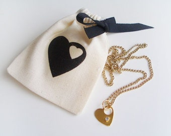 """Mini heart & rhinestone gold necklace (16"""") with matching pouch"""