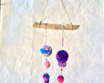 Two strand handmade pompom wall hanging