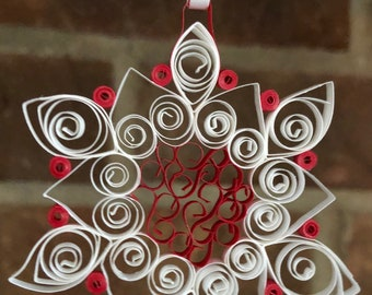 Paper quilled red and white snowflake