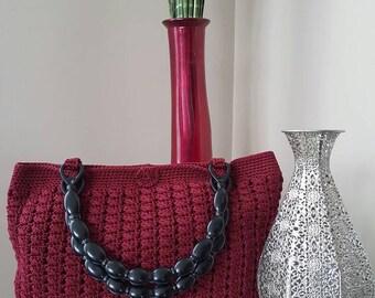 Red macrame handbag