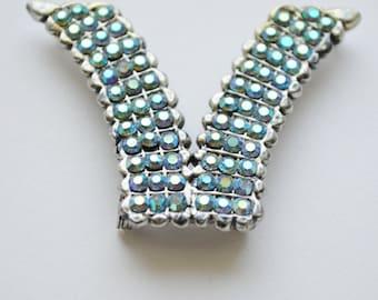 iridescent rhinestone brooch. silver jewelry. vintage brooch. v shaped