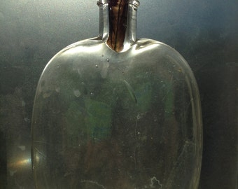A very antique bubble mouth-blown bottle/ flask with some mysterious original contents from the 1800's