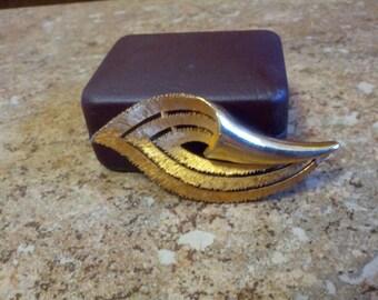 Lovely stamped J.J.  brushed gold tone metal brooch