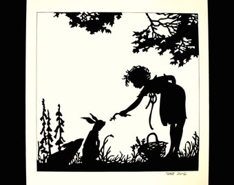 papercut silhouette the child and the rabbit