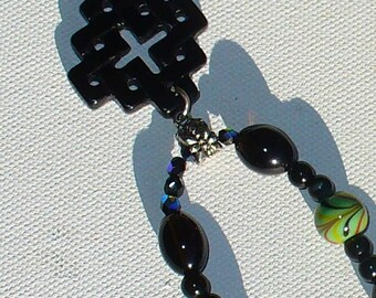 Celtic knot long necklace - black pendant with green red and black beads