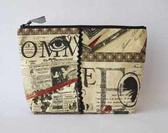 Toiletry bag in vintage black and red fabric lined ecru linen