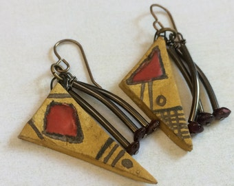Asymmetric, geometric, ceramic drop earrings.Resin wax. Red glaze. Glass tubes. Ruby glass.